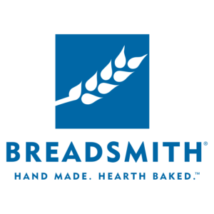 A white stalk of wheat on a blue square with the words Breadsmith - Hand Made. Hearth Baked.